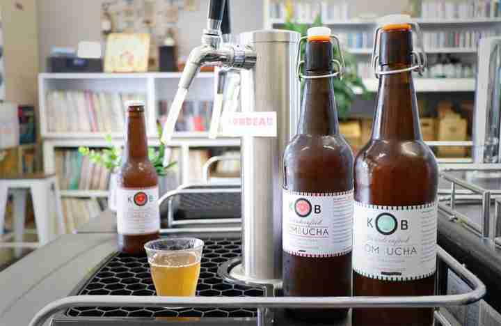 KB Kombucha bottles near taps