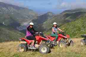 Wellington Quad Bike Adventures two people on bikes with view of Orongorongo River