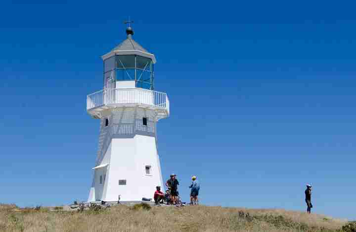 pencarrow lighthouse close up of top lighthouse cyclists taking in view
