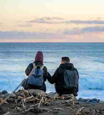 wainuiomata coast couple watching the sunset