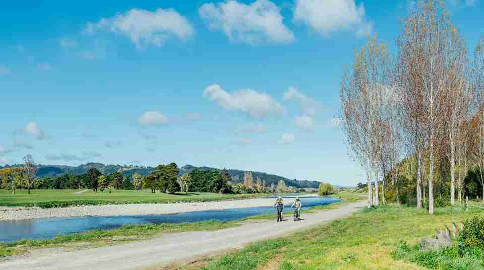 Hutt River Trail people cycling along river credit Jay French
