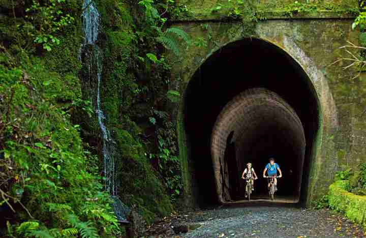 Remutaka Cycle Trail and Rail Trail two cyclists in tunnel